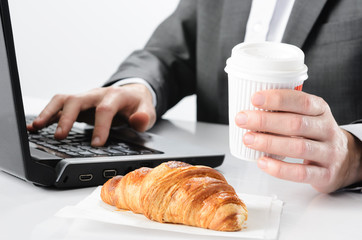 Coffee and croissant breakfast at work