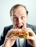 Funny business man eating sandwich