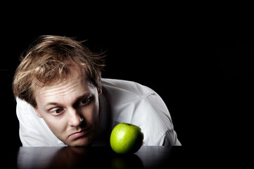 Bright idea business concept with fresh healthy green apple