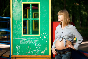 Beautiful Pregnant woman on the playground