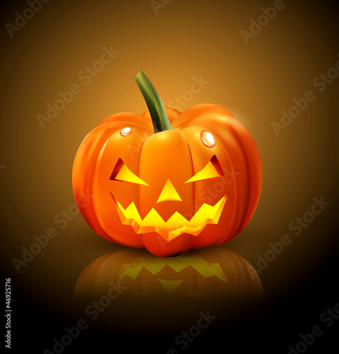 Halloween Pumpkin isolated on a dark background with reflection