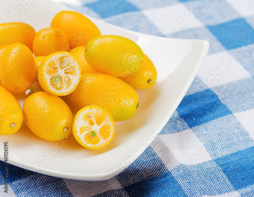 Yellow kumquat on nature background.