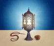 Ramadan Concept of lamp, Rosary , & Dates served after fasting