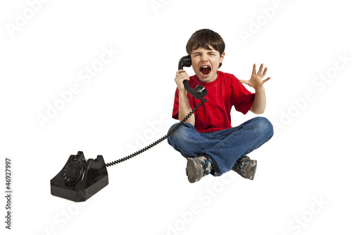 angry child on the phone, isolated on white background