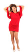 Beautiful woman dressed in red dress dances in studio on white
