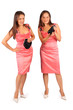 Two same women wearing pink evening dress in studio on white