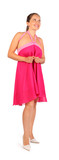 Beautiful woman wearing pink dress smiles in studio on white