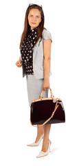 Beautiful business woman wearing in suit holds bag in studio