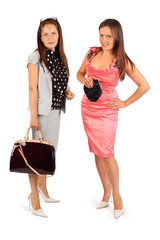 Two same women wearing business suit and pink evening dress
