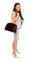 Young beautiful business woman holds bag in studio on white
