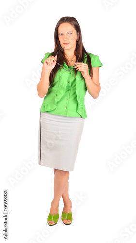 Young beautiful business woman holds glasses in studio on white