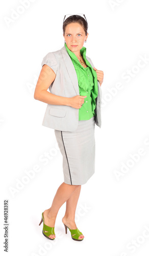 Young beautiful business woman poses in studio on white
