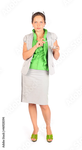 Young beautiful business woman holds ashtray and smokes