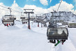 Ski chair-lift with skiers in snow-capped mountains in Austrian