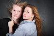 brown hair woman in shirt hug long hair boy in photo studio