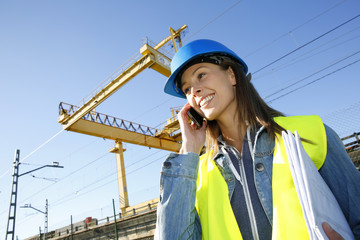 Construction manager talking on mobile phone