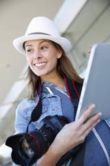 Smiling photographer using digital tablet
