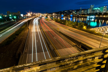 Traffic headlights streak down the I-5 freeway along the Portlan