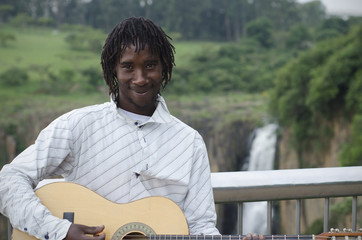 African busker in front of Howick Falls
