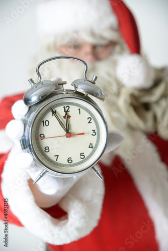 Weihnachtsmann mit Wecker