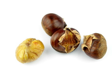 Roasted chestnuts on white background