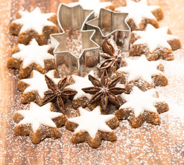 cinnamon stars and star anise on wood