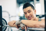 Young man having a rest in the gym.