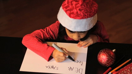 Six Year Old Girl Writing Santa Claus