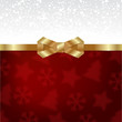 Elegant Christmas background with shiny gold bow.