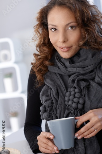 Portrait of attractive female drinking tea