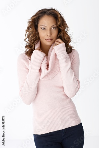 Portrait of attractive female in pullover