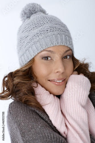Attractive female in winter clothes smiling