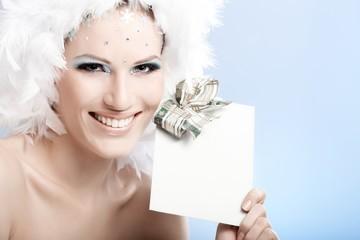 Happy winter beauty holding fancy present