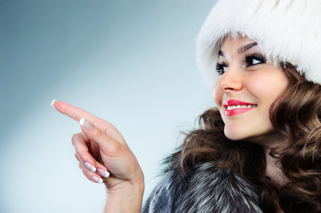 Young woman in white fur hat