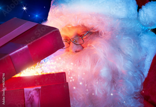 Santa Claus with Magic Christmas Gift