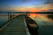 Steg, Boot und Sonnenuntergang