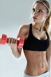 Slim and sporty girl do exercise with dumbbells - 46937523