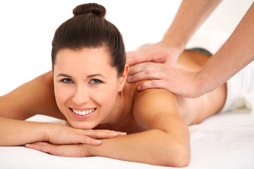 Smiling woman getting relaxing spa massage