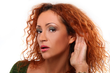 Beautiful redhead woman listening gesture