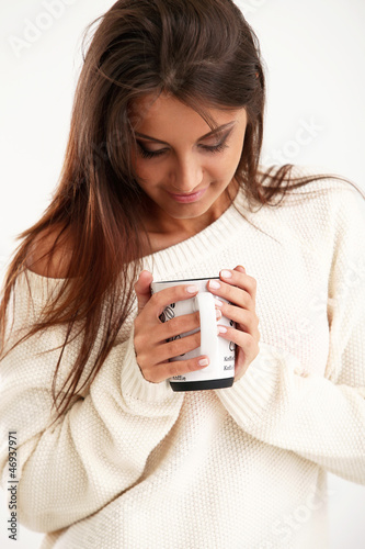 Attractive and young girl holding a cup