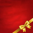 Gold Satin Bow And Red Vintage Background