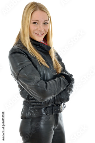 Junge Frau in Motorradkombi