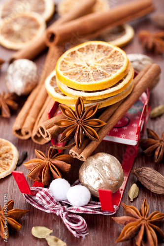 Christmas spices: star anise, cinnamon, cardamom and  oranges