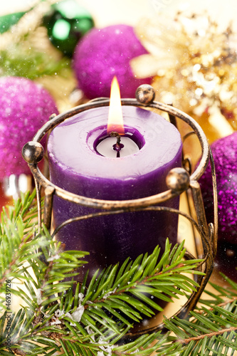 Christmas concept with a burning candle