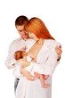 Happy family, father mother and baby. Mom breast feeding newborn
