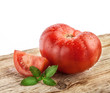 Tomatoes on grunge wooden background