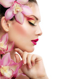 Fototapety Beauty Portrait. Beautiful Stylish Girl with Orchid Flower