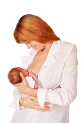 Beautiful red-haired mom and baby. Isolated on white
