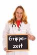 Ärztin mit Schild - Grippezeit