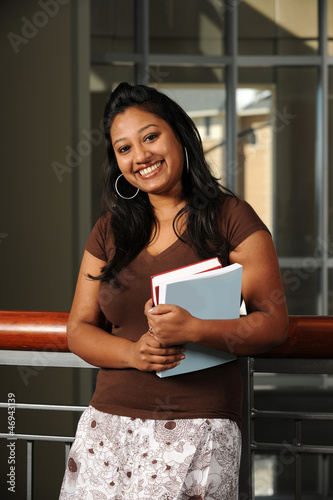 Young Eastern Student holding Books in College Campus